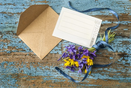 post: Envelope and postcard on an old wooden surface Stock Photo