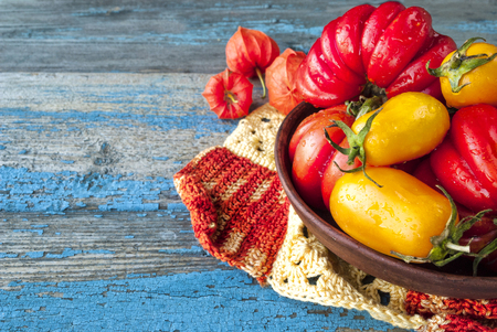 Ripe tomatoes on a wooden surface. Copyspace