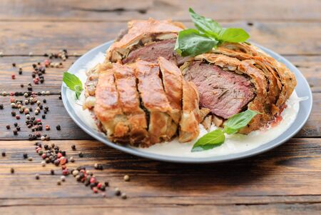 beef tenderloin festive dish. baked meat in dough