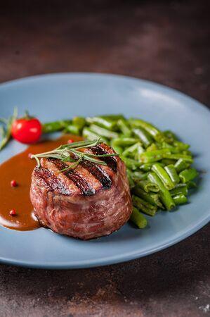 Beef steak medium grilled, isolated on white background. steak medallion
