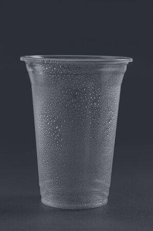 Empty plastic glass on a gray background. Reklamní fotografie