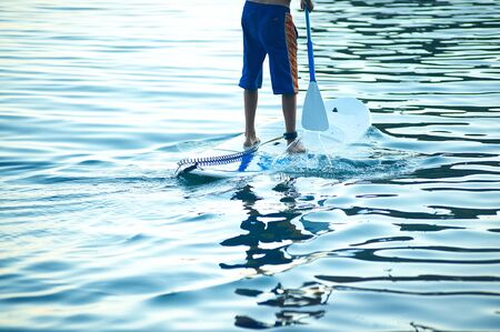 Stand Up Paddling in the sea. Stock Photo