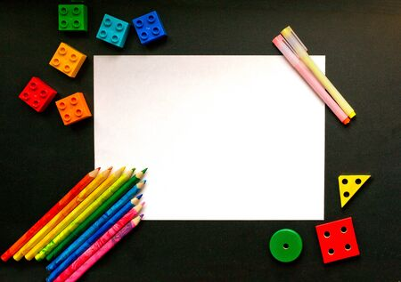 colorful pencils and designer detail on the school board flat lay