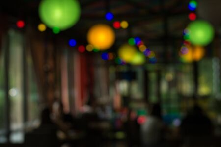 Lights in a cafe in the evening. Blurred background, copy space for display of product or object presentation. Vacation concept