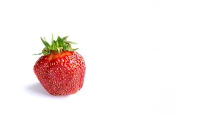 Sweet strawberry lies on a white background, isolate, place for text Reklamní fotografie