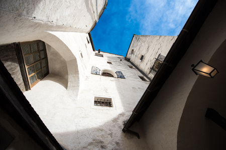 lattice window: White walls and windows of ancient building and blue sky