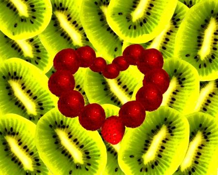 El corazón de fresa sobre un fondo kiwis