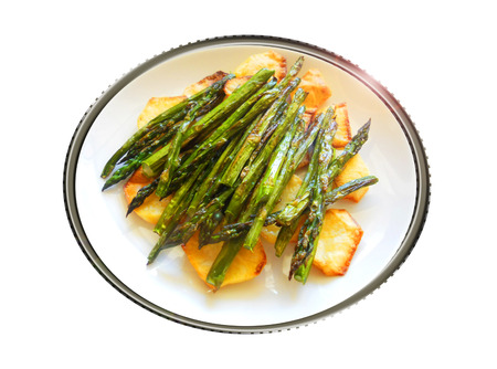 Backed green asparagus with potatoes. Composition