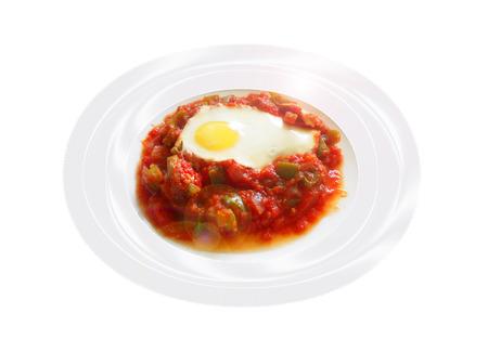 Huevos con tomate y pimienta.