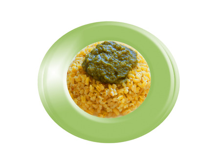 Wheat with spinach sauce. Composition. Foto de archivo
