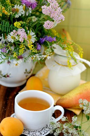 Field flowers and chamomile tea (background) Stock Photo