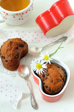 Just baked fruit chocolate muffins in heart shaped capcakes.