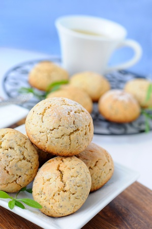 Homemade poppy cookies on a  light  blue background.