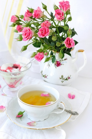 Rose bouquet and cup of tea Stock Photo - 9267147
