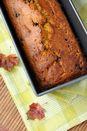 baked bread: A home baked pumpkin bread with chocolate pieces. Stock Photo