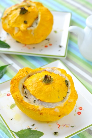 Pattypan squashes stuffed with cheese and vegetables. Stock Photo