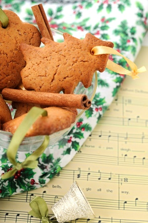 Christmas composition: honey-ginger cookies and a bell with musical noteJingle Bells as a background. photo