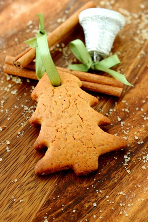 Christmas cookies with cinnamon and a little bell.  photo