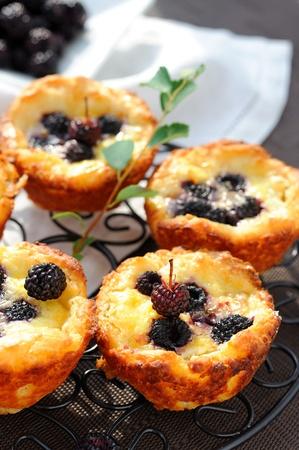 Homemade cheese buns with black raspberries.