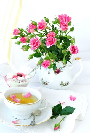 Rose bouquet and cup of tea. photo