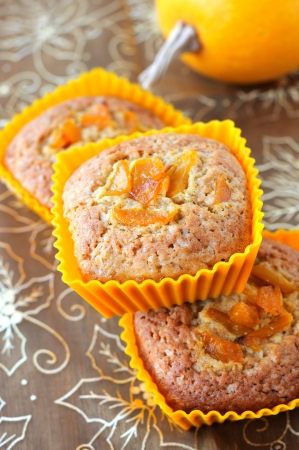 Sweet pumpkin muffins in сupcakes decorated with caramelized pumpkin