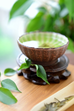 Healthy green tea cup with leaves photo