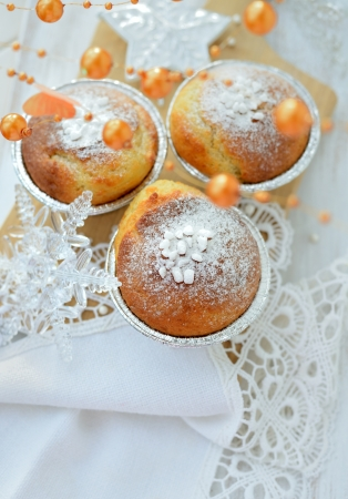Close-up of Christmas muffins decorated with powdered sugar  photo