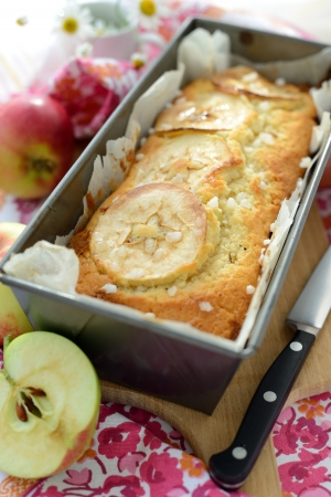 A home baked apple cake pan  with apple pieces