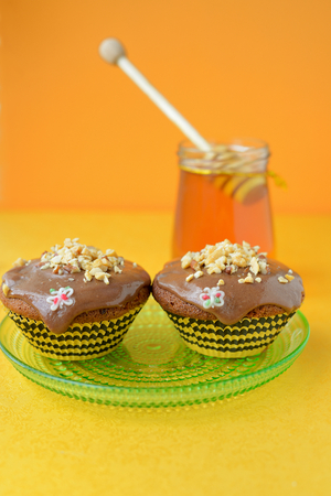 Homemade honey cake, decorated with nuts   photo