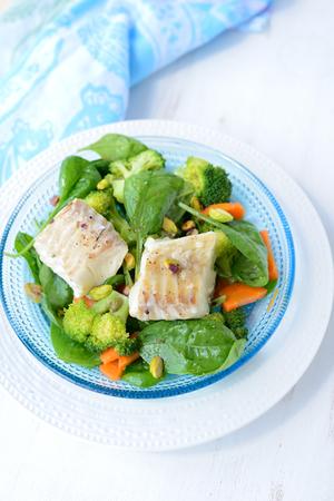 haddock: Braised fish  haddock  with vegetables