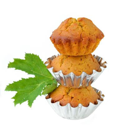 Three pumpkin muffins on white background photo
