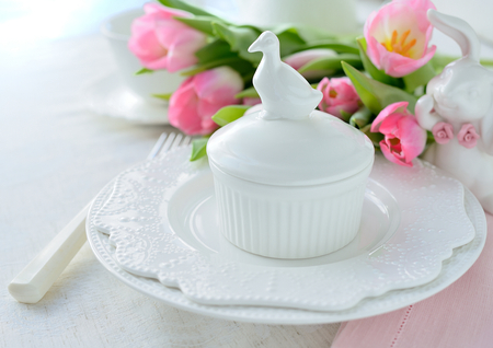 place setting: Place setting with pink tulips at the background