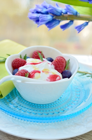 Ice cream with raspberries and blueberries