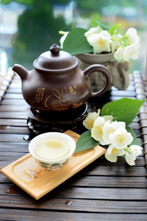 Healthy oolong tea cup with leaves Stock Photo
