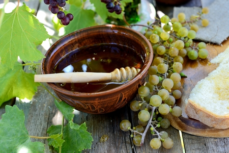Still life with honey, grapes and white bread