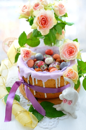 Easter decoration with eggs, rabbits and flowers