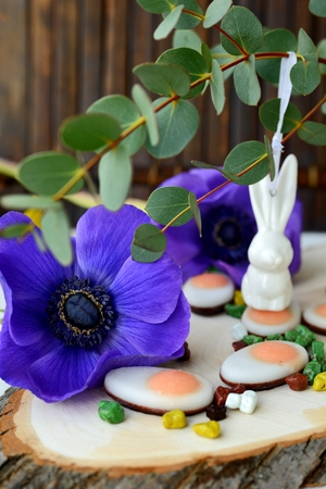 Easter sweets and easter eggs with spring flowers