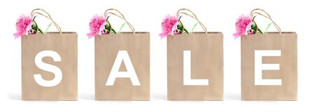 eco paper shopping bags and the word sale. long banner white background. summer flowers concept