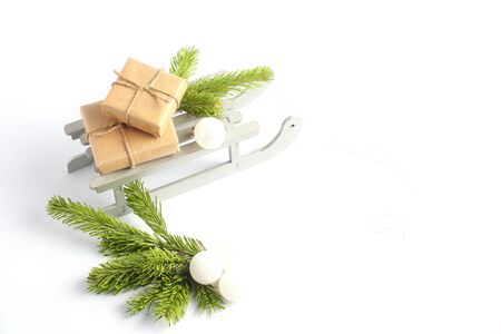 Christmas sleigh with gifts. New Years concept. decorative toys in the form of white balls and green branches of spruce
