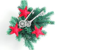 Christmas arrangement of branches of spruce and toys in the form of keys and stars. Flat lay, top view, banner with space for a text