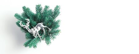 Long horizontal banner with place for text. Christmas composition from the branches of spruce and toys in the form of a deer. Flat lay, minimal layout.