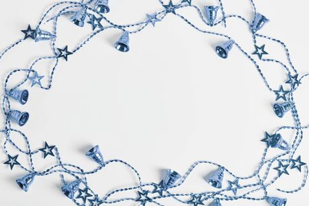 new year concept. the frame of blue Christmas beads on a white background. flat lay, top view, space for a text.
