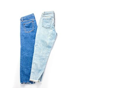 dark blue and light blue jeans on a white background. isolated objects. casual clothing set. space for a text