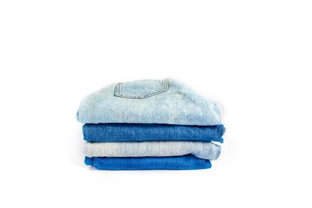 a stack of jeans in light blue and dark blue on a white background. copy space. Stock Photo