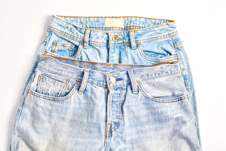 online shopping concept. two pairs of blue jeans. simple flat lay, top view. 免版税图像