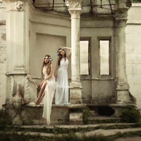 Two young attractive beautiful blonde woman in greek style.  grain and texturer added photo
