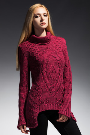 Young beautiful adult girl wearing elegant winter sweater Studio shot photo