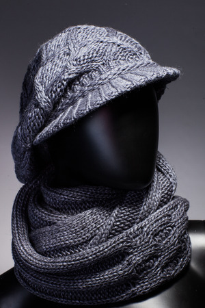 Mannequin with hat and scarf. Stock Photo