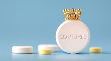 coronavirus COVID-19 macro foto. Dangerous virus. Medicine. Pills. Crown. Concept medicine. Health. Blue isolated background