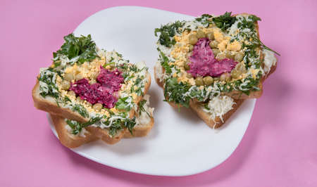 Sandwiches with edible hearts on pink background. Food art idea for Valentine day, birthday, mother's day.
